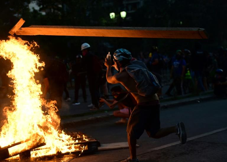 A demonstrator takes part in a violent protest in Santiago