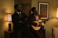 """This image released by Amazon Studios shows Aldis Hodge, left, and Leslie Odom Jr. in a scene from """"One Night in Miami."""" (Patti Perret/Amazon Studios via AP)"""