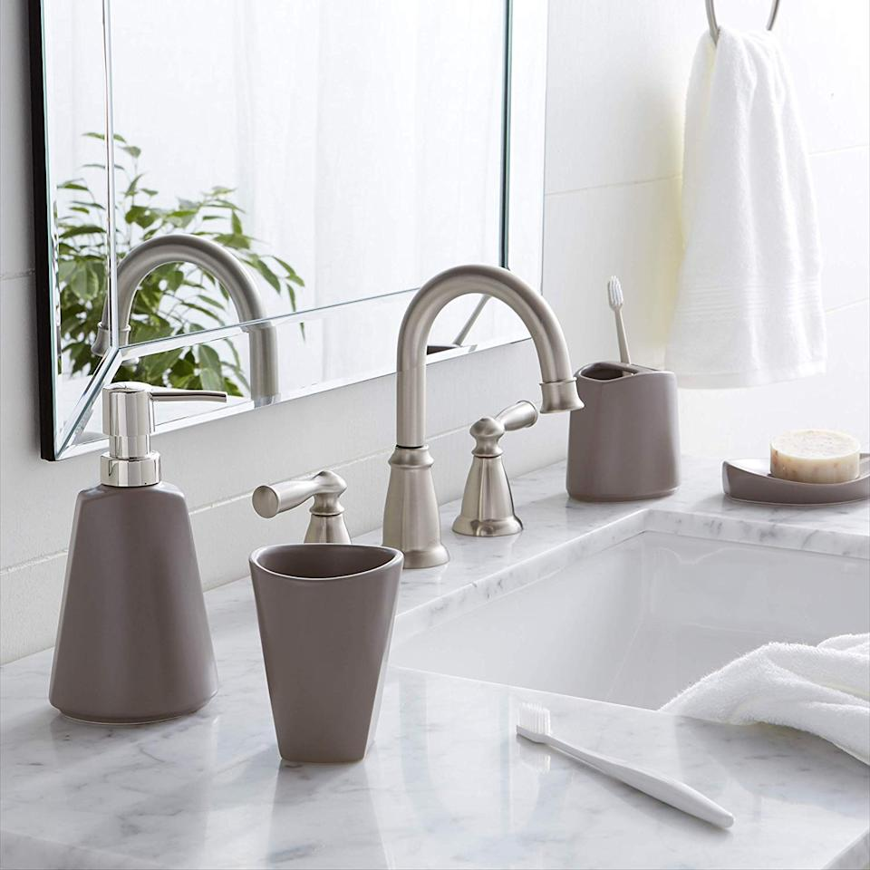Hide unsightly liquid soap bottles and toothbrush holders with this chic (and shockingly affordable) set. (Photo: Amazon)