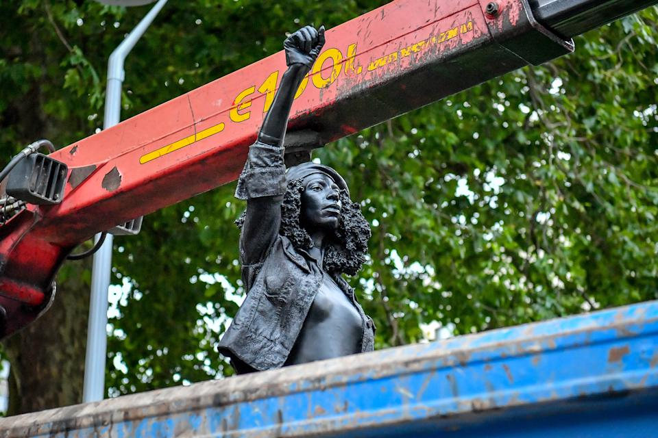 A Surge of Power (Jen Reid) 2020, by prominent British sculptor Marc Quinn, which has been installed in Bristol on the site of the fallen statue of the slave trader Edward Colston, is removed from the plinth and loaded into a recycling and skip hire lorry.