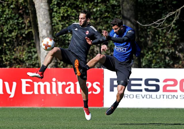Soccer Football - Europa League - AC Milan Training - Milanello Sport Center, Milan, Italy - March 14, 2018 AC Milan's Hakan Calhanoglu and Mateo Musacchio during training REUTERS/Stefano Rellandini