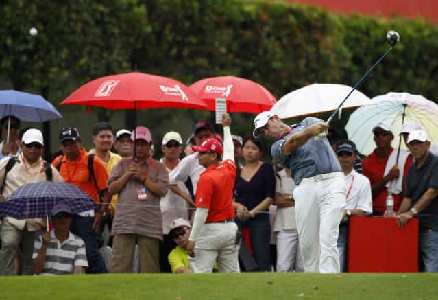 Gary Woodland of the U.S. tees off on the 10th hole during the final round of the CIMB Classic golf tournament at the Kuala Lumpur Golf and Country Club in Kuala Lumpur, Malaysia, Sunday, Oct. 27, 2013. Woodland and his compatriot Ryan Moore finished tied for the lead after the final round of the tournament on Sunday, with the sudden-death playoff postponed until Monday due to darkness. (AP Photo/Lai Seng Sin)