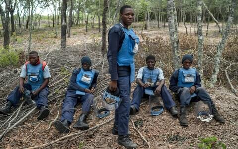 De-miners take a break from a mine field in Cuito Cuanavale, Angola. - Credit: JOAO SILVA/NYTNS / Redux / eyevine