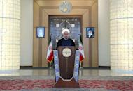 Iranian President Hassan Rouhani delivers a live televised address from Tehran, on July 14, 2015 (AFP Photo/)