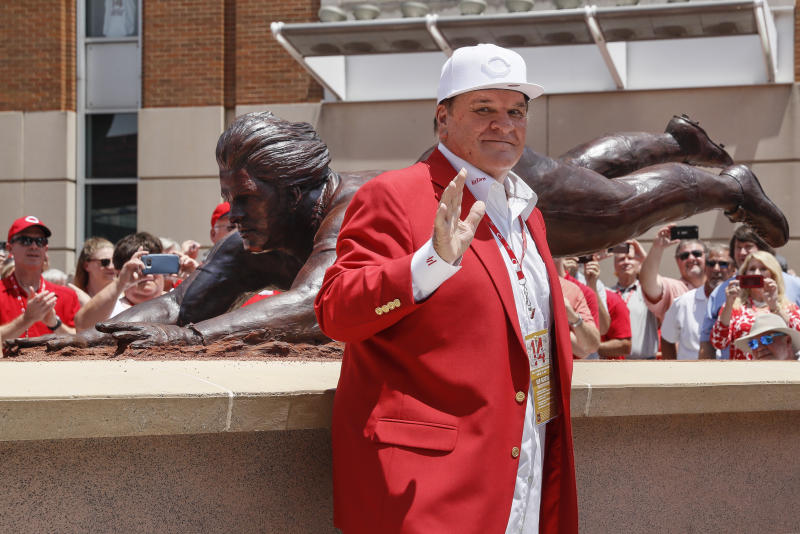 Former Cincinnati Reds player Pete Rose smiles as he stands for pictures during the dedication of his statue outside Great American Ballpark prior to a baseball game between the Cincinnati Reds and the Los Angeles Dodgers, Saturday, June 17, 2017, in Cincinnati. (AP Photo/John Minchillo)