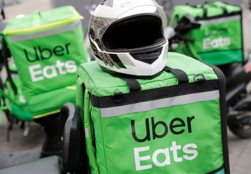 Delivery bags with logos of Uber Eats are seen on a street in central Kiev