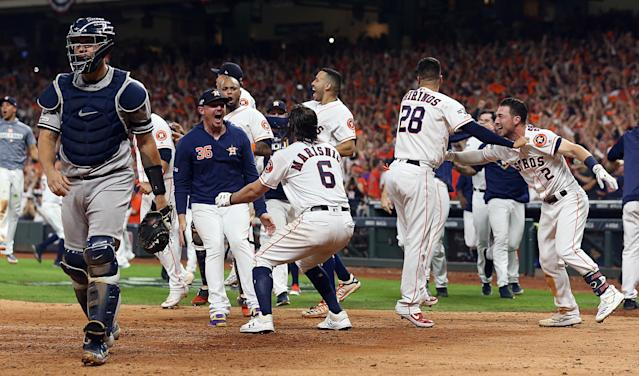 """The <a class=""""link rapid-noclick-resp"""" href=""""/mlb/teams/houston/"""" data-ylk=""""slk:Astros"""">Astros</a> are projected to celebrate another AL West championship in 2020. (Photo by Bob Levey/Getty Images)"""