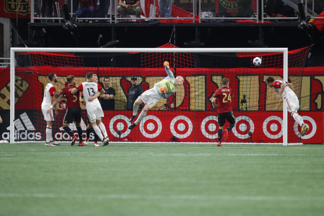D.C. United midfielder Nick DeLeon, right, attempts a shot in the first half of an MLS soccer game against the Atlanta United FC on Sunday, March 11, 2018, in Atlanta. (AP Photo/Todd Kirkland)