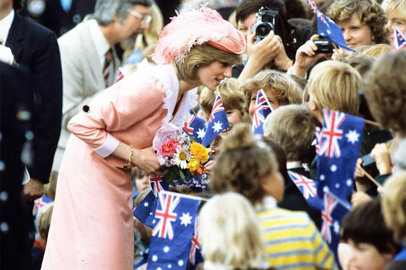 Greeting Australian children in a Sloane Ranger look, head-to-toe pink.