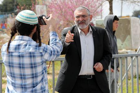 Michael Ben-Ari from the Jewish Power party visits the scene of the shooting attack near the Jewish settlement of Ariel, in the Israeli-occupied West Bank March 17, 2019. Picture taken March 17, 2019. REUTERS/Ammar Awad