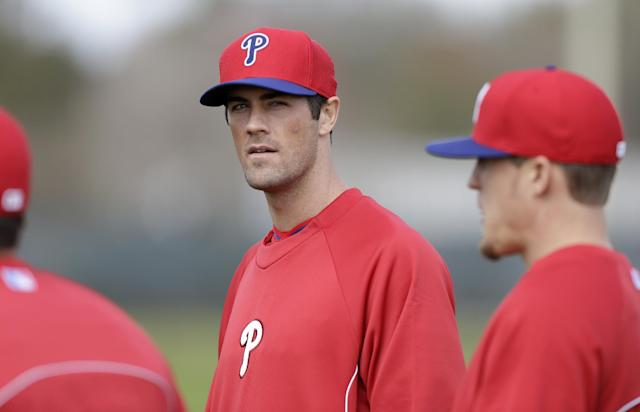 Philadelphia Phillies starting pitcher Cole Hamels looks on during spring training baseball practice Thursday, Feb. 13, 2014, in Clearwater, Fla. (AP Photo/Charlie Neibergall)
