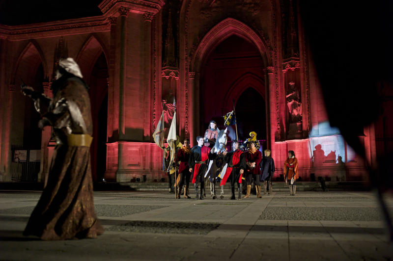 Pauline Finet, center, performs as Joan of Arc during the opening ceremony of the 600th anniversary of the birth of Joan of Arc, in Orleans, central France, Sunday April 29, 2012. The city of Orleans goes all out with celebrations marking the 600th birthday of Joan of Arc, a national icon and symbol of French resistance through the ages at a time when French identity and France's role in the world are a focus in the presidential campaign.  (AP Photo/Thibault Camus)