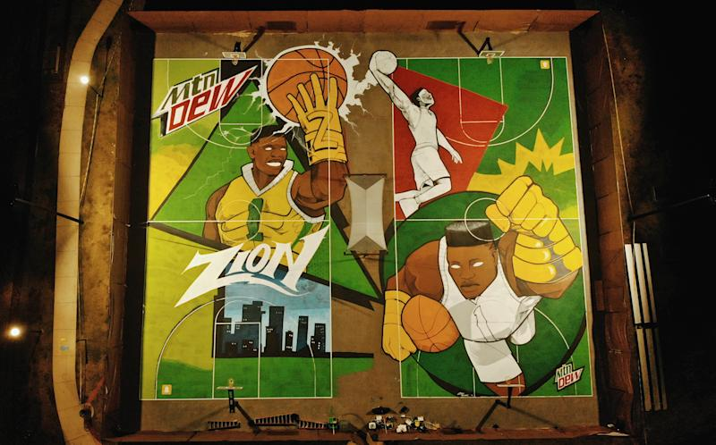 Ceaux Young created murals on adjacent basketball courts at Stewart Park in Spartanburg, SC celebrating Zion Williamson's roots at the school and his rise to the NBA. (Jamal Barnes/Mountain Dew)