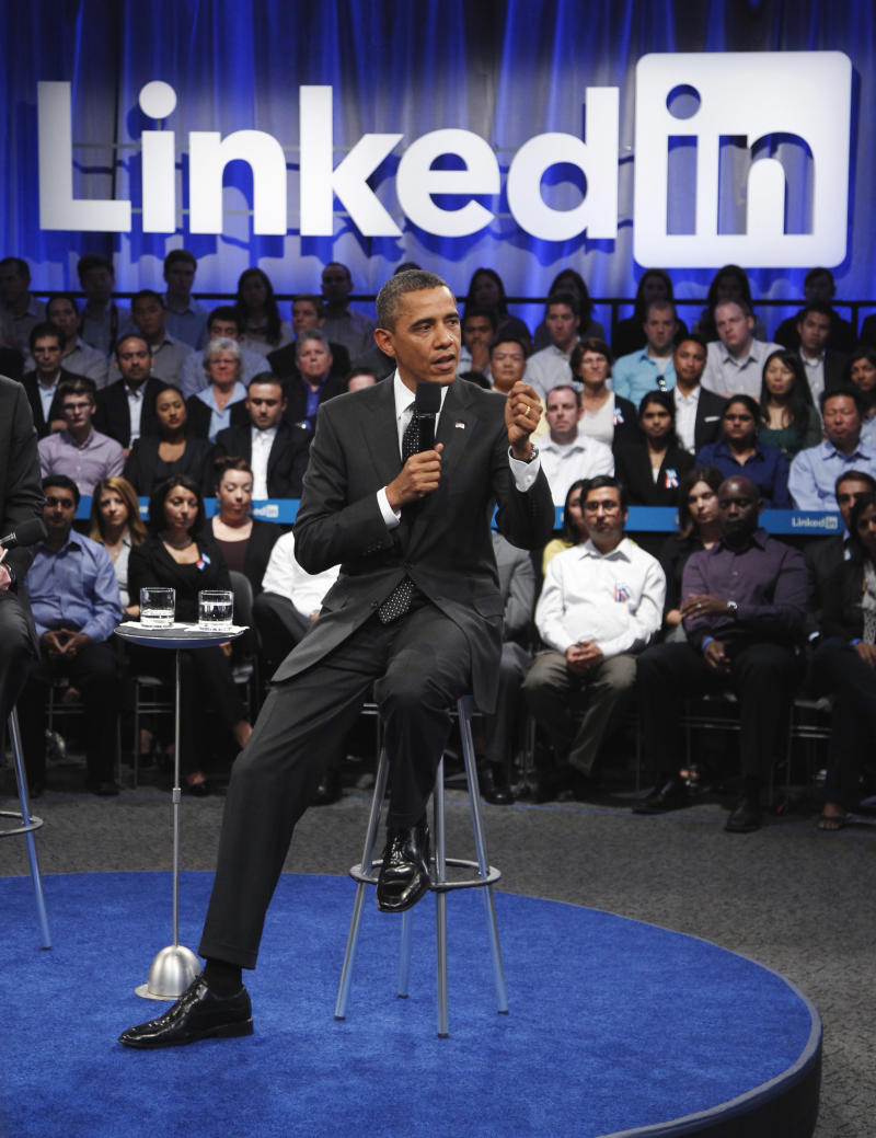 "President Obama gestures during a LinkedIn Town Hall Meeting at the Computer History Museum in Mountain View, Calif., Monday, Sept. 26, 2011, as he participates in ""Putting America Back to Work: LinkedIn Presents a Town Hall with President Obama.""  (AP Photo/Paul Sakuma)"