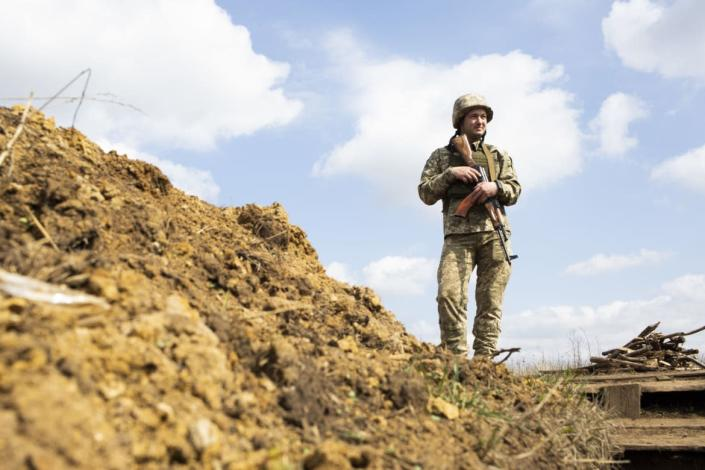 """<div class=""""inline-image__caption""""><p>A Ukrainian soldier stands near the front line, looking toward territory controlled by the Russian-backed separatists.</p></div> <div class=""""inline-image__credit"""">Emil Filtenborg</div>"""