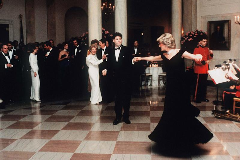 WASHINGTON, UNITED STATES - NOVEMBER 09: (FILE PHOTO) Diana, Princess Of Wales, watched by President Ronald Reagan and wife Nancy, dances with John Travolta at the White House, USA on November 9, 1985. Diana is wearing a midnight blue velvet dress by designer Victor Edelstein. (Photo by Anwar Hussein/WireImage)On July 1st Diana, Princess Of Wales would have celebrated her 50th BirthdayPlease refer to the following profile on Getty Images Archival for further imagery. http://www.gettyimages.co.uk/Search/Search.aspx?EventId=107811125&EditorialProduct=ArchivalFor further images see also:Princess Diana:http://www.gettyimages.co.uk/Account/MediaBin/LightboxDetail.aspx?Id=17267941&MediaBinUserId=5317233Following Diana's Death:http://www.gettyimages.co.uk/Account/MediaBin/LightboxDetail.aspx?Id=18894787&MediaBinUserId=5317233Princess Diana - A Style Icon:http://www.gettyimages.co.uk/Account/MediaBin/LightboxDetail.aspx?Id=18253159&MediaBinUserId=5317233