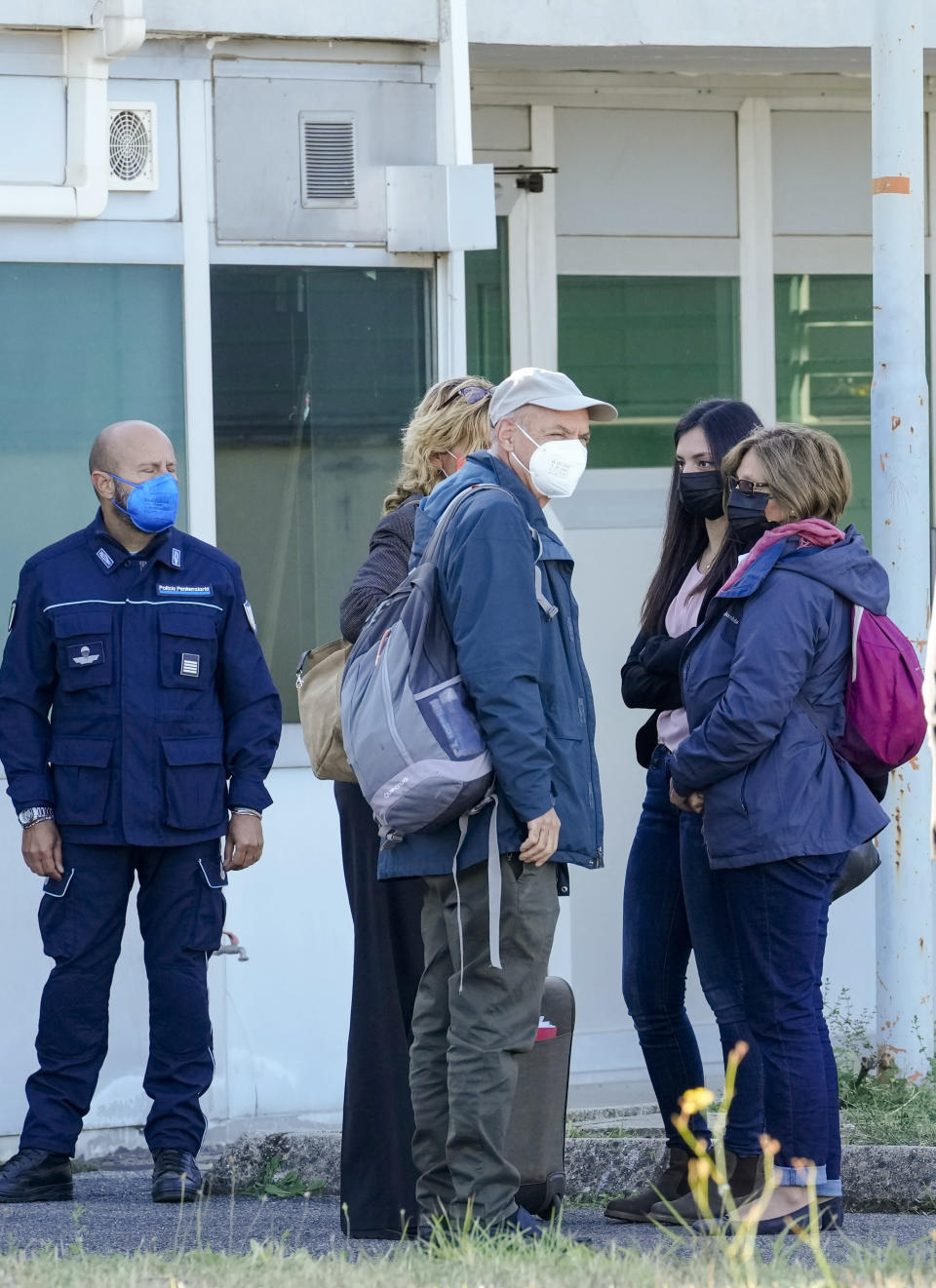 The family of slain Italian doctoral student Giulio Regeni, from right, mother Paola Regeni, Giulio's sister Irene, and father Claudio arrive with their lawyer Alessandra Ballerini, fourth from right, at the Rebibbia prison in Rome, Thursday, Oct. 14, 2021, to attend the first hearing of the trial for the death of Italian doctoral student Giulio Regeni, who disappeared for several days in January 2016 before his body was found on a desert highway north of the Egyptian capital. Italian prosecutors have formally put four high-ranking members of Egypt's security forces under investigation for their alleged roles in the slaying. (AP Photo/Andrew Medichini)