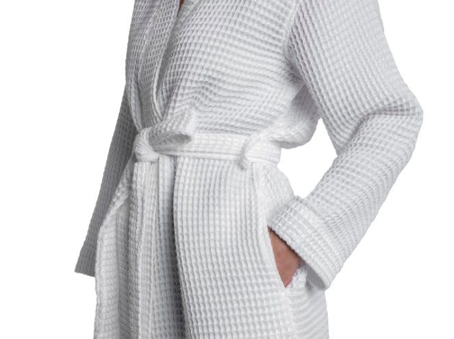 """<p>If you want the luxury of a spa robe with a lightweight feel and a flirty length, look no further than <a href=""""https://www.parachutehome.com/products/waffle-robe?opt-color=white"""" rel=""""nofollow"""">Parachute Home's waffle-weave Turkish cotton robe</a>. It's available in classic white, natural tan, and a cool heather gray — so go ahead and match yourself to your bedding and sink in for some serious relaxation.</p> <p><em>Sizes Available: Small to Extra Large</em></p> <p><strong>$119</strong> <a href=""""https://www.parachutehome.com/products/waffle-robe?opt-color=white"""" rel=""""nofollow"""">(Shop Now)</a></p>"""