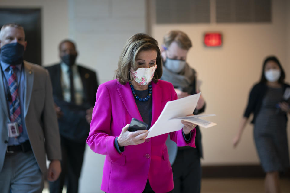 FILE - In this Thursday, Feb. 25, 2021 file photo, Speaker of the House Nancy Pelosi, D-Calif., walks to a news conference as the Democratic-led House prepares to pass a bill that enshrines protections in the nation's labor and civil rights laws for LGBTQ people, a top priority of President Joe Biden, at the Capitol in Washington. It probably needs at least 10 Republican votes to prevail in the closely divided Senate – and as of early June 2021 has no GOP co-sponsors. (AP Photo/J. Scott Applewhite, File)