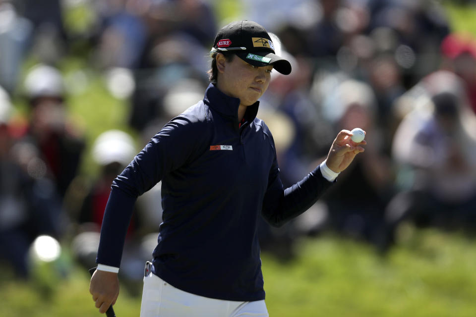 Yuka Saso, of the Philippines, waves after making her putt on the 18th green during the final round of the U.S. Women's Open golf tournament at The Olympic Club, Sunday, June 6, 2021, in San Francisco. (AP Photo/Jed Jacobsohn)