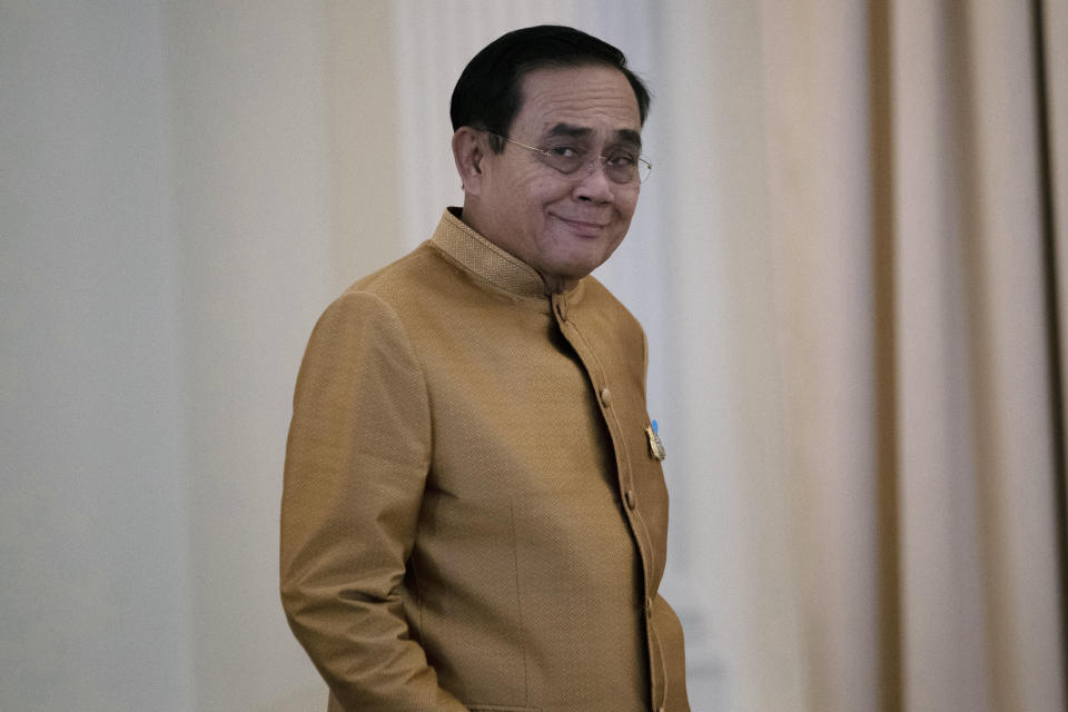 Thailand's Prime Minister Prayuth Chan-ocha arrives to speak to the media during a press conference at Government House in Bangkok, Thailand, Tuesday, Dec. 1, 2020. Thailand's highest court is set to rule Wednesday, Dec. 2, 2020 on whether Prayuth has breached ethics clauses in the country's constitution and should be ousted from his position. (AP Photo/Sakchai Lalit)