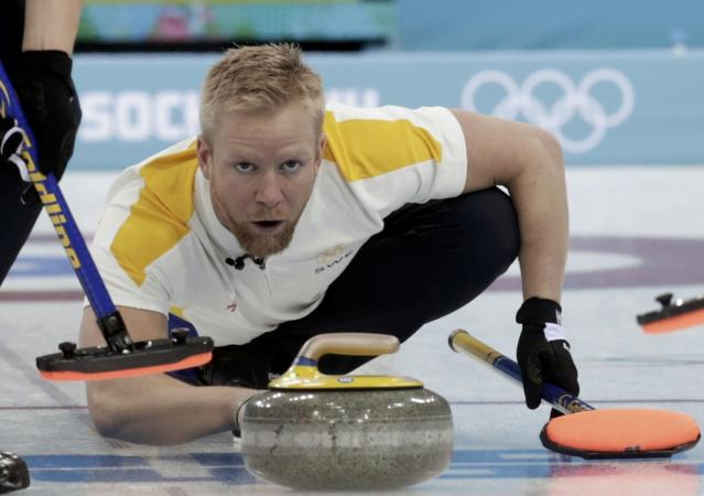 Sweden's skip Niklas Edin delivers a stone during their men's curling round robin game against Switzerland at the 2014 Sochi Olympics in the Ice Cube Curling Center in Sochi February 10, 2014. REUTERS/Ints Kalnins (RUSSIA - Tags: OLYMPICS SPORT CURLING)