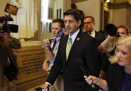 House Budget Committee Chairman Ryan talks to reporters as he walks on the U.S. Capitol building in Washington