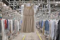 """A garment hangs in the automated sortation section at Rent the Runway's """"Dream Fulfillment Center"""" in Secaucus, New Jersey"""