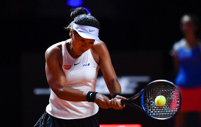 Osaka battles to reach Porsche Grand Prix semis