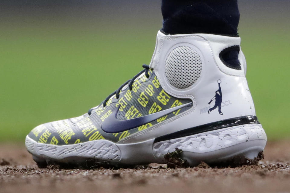 Milwaukee Brewers' Christian Yelich wears shoes honoring broadcaster Bob Uecker during the second inning of a baseball game against the New York Mets Saturday, Sept. 25, 2021, in Milwaukee. (AP Photo/Aaron Gash)