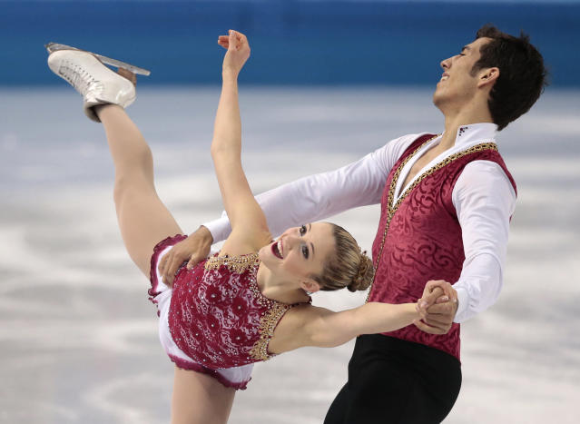 Paige Lawrence and Rudi Swiegers of Canada compete in the pairs free skate figure skating competition at the Iceberg Skating Palace during the 2014 Winter Olympics, Wednesday, Feb. 12, 2014, in Sochi, Russia. (AP Photo/Ivan Sekretarev)