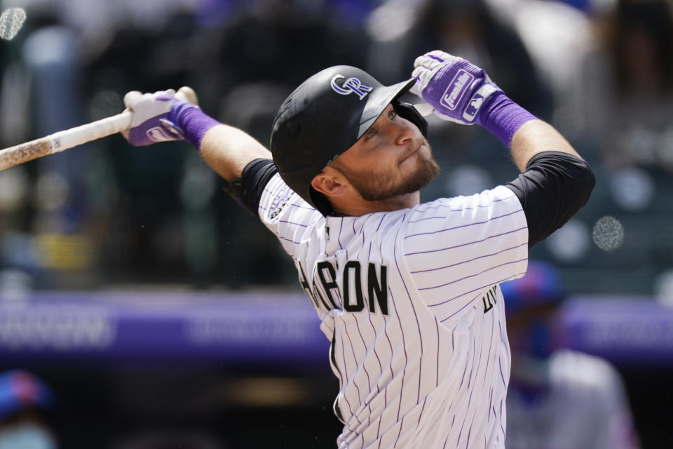 Colorado Rockies' Garrett Hampson flies out in the fifth inning of a baseball game Sunday, April 18, 2021, in Denver. (AP Photo/David Zalubowski)