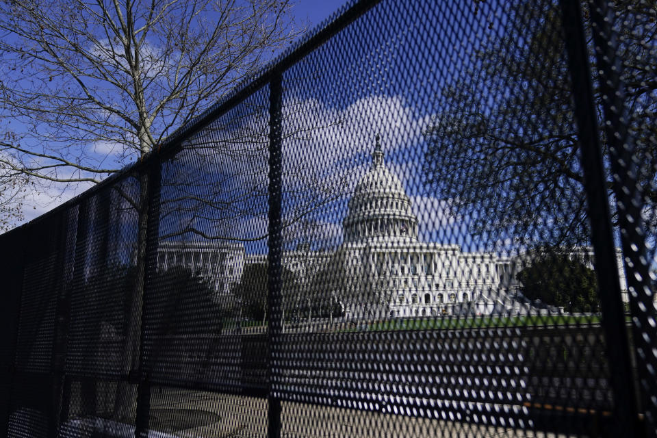"""FILE - In this April 2, 2021, file photo, the U.S. Capitol is seen behind security fencing on Capitol Hill in Washington. Far right extremist groups like the Proud Boys and Oath Keepers are planning to attend a rally in September at the U.S. Capitol that is designed to demand """"justice"""" for the hundreds of people who have been charged in connection with January's insurrection, according to three people familiar with intelligence gathered by federal officials. As a result, U.S. Capitol Police have been discussing in recent weeks whether the large perimeter fence that was erected outside of the Capitol after January's riot will need to be put back up, the people said. (AP Photo/Carolyn Kaster, File)"""