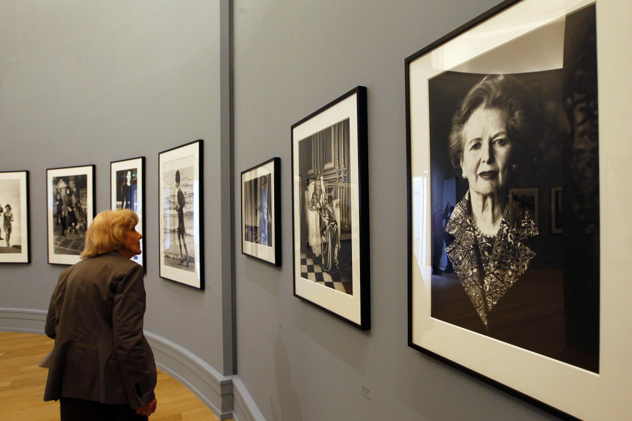 A visitor looks at the work of late fashion photographer Helmut Newton at the opening of his first retrospective in France at the Grand Palais museum, Paris, Friday, March 23, 2012. The exhibit, curated by his widow June Newton, contains some 250 pictures, many of which are provocative and erotically charged. His black-and-white photos were a mainstay of fashion magazines across the world for several decades, especially Vogue Paris. (AP Photo/Francois Mori)
