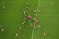 "Rugby is a game of strength, speed, and skill, but also of strategy and positioning. Mike Hewitt (Getty Images) captures the bigger picture as Wales thrash Georgia 43 - 14. Mike says: ""I really like how the attack and defence is symmetrical and this is visible through patterns and leading lines making this an aesthetically pleasing image."""