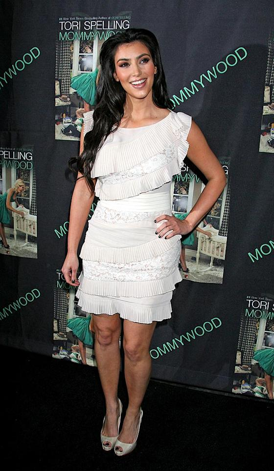 "Kim Kardashian continued to impress at Tori Spelling's ""Mommywood"" book signing in a ruffled white cocktail dress and cute peep toes. Russ Einhorn/<a href=""http://www.splashnewsonline.com"" target=""new"">Splash News</a> - April 13, 2009"