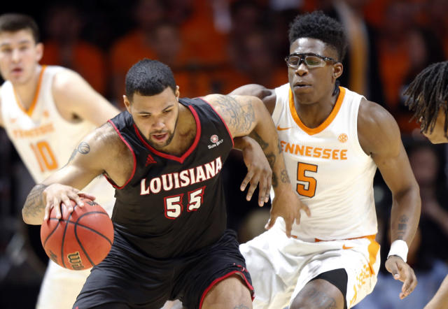 Louisiana-Lafayette forward Justin Miller (55) works for a shot as he's defended by Tennessee guard Admiral Schofield (5) during the first half of an NCAA college basketball game Friday, Nov. 9, 2018, in Knoxville, Tenn. (AP photo/Wade Payne)