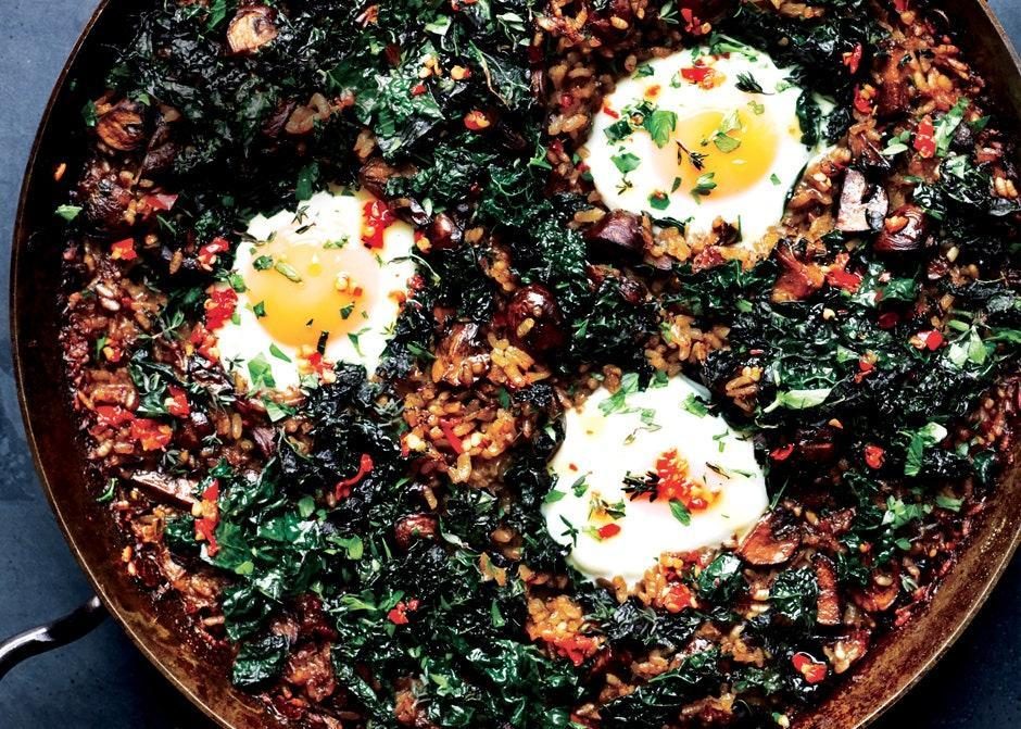 "The best part of any paella is the crisp layer of rice that forms on the bottom of the pan. Make sure to scrape some out for each portion. <a href=""https://www.bonappetit.com/recipe/mushroom-paella-with-kale-and-eggs?mbid=synd_yahoo_rss"" rel=""nofollow noopener"" target=""_blank"" data-ylk=""slk:See recipe."" class=""link rapid-noclick-resp"">See recipe.</a>"