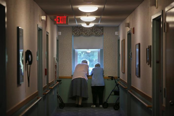 """Nursing homes and long-term care facility residents, like these women photographed in Marlborough, Mass., in August, are particularly vulnerable to COVID-19. <span class=""""copyright"""">Craig F. Walker—The Boston Globe/Getty Images</span>"""