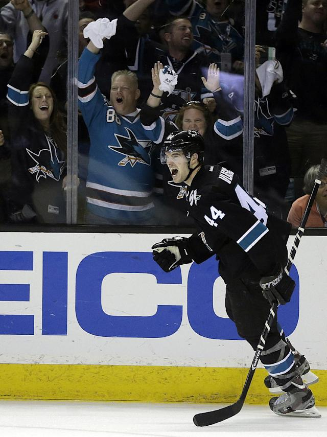 San Jose Sharks' Marc-Edouard Vlasic (44) celebrates after scoring against the Los Angeles Kings during the second period of Game 1 of an NHL hockey first-round playoff series Thursday, April 17, 2014, in San Jose, Calif. (AP Photo/Ben Margot)