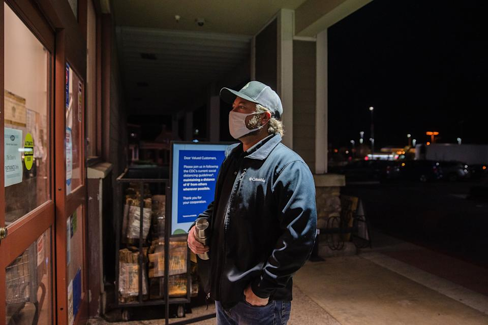 Mike Kurtz, a meat manager at a Ralphs on Carmel Mountain Road in San Diego, waits for an employee to let him in the store at 4 a.m. so he can start his shift. (Photo: Ariana Drehsler for HuffPost)