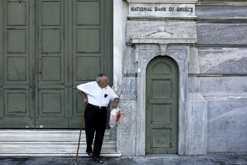 More than 1,000 bank branches were opened to allow Greek pensioners without cards to withdraw 120 euros ($133) (AFP Photo/Angelos Tzortzinis)