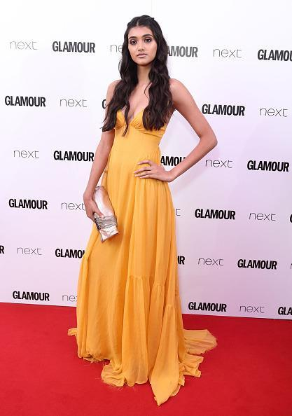 <p>Neelam Gill opted for a vibrant orange dress by Tory Burch. <i>[Photo: Mike Marsland/Mike Marsland/WireImage]</i></p>