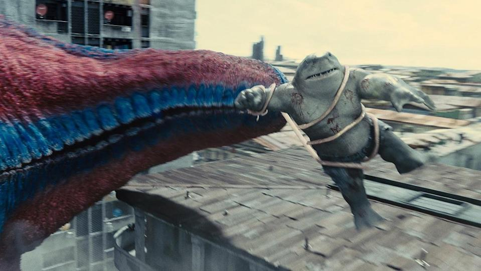 King Shark gets flung around by Starro's tendril in The Suicide Squad.