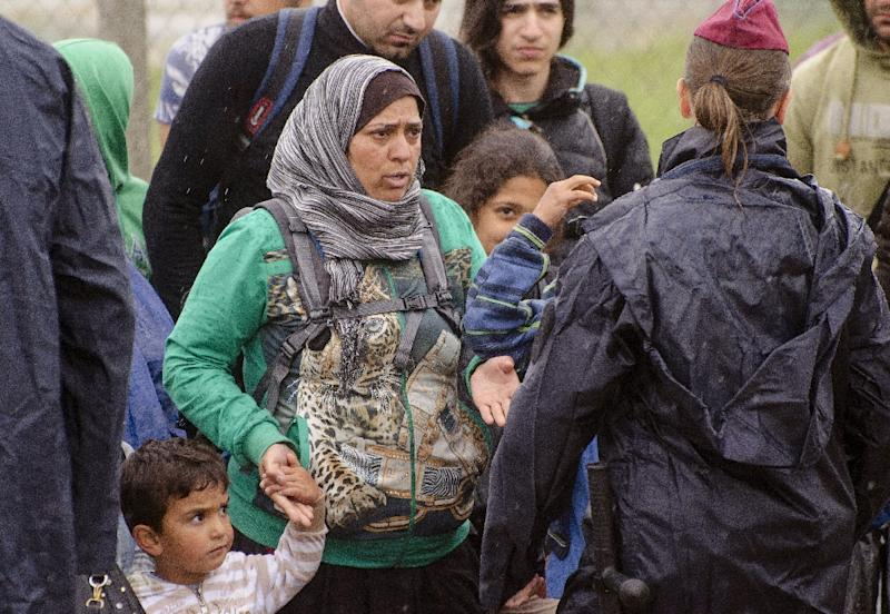 Police collect migrants as they patrol the Hungarian-Serbian border near the town of Szeged
