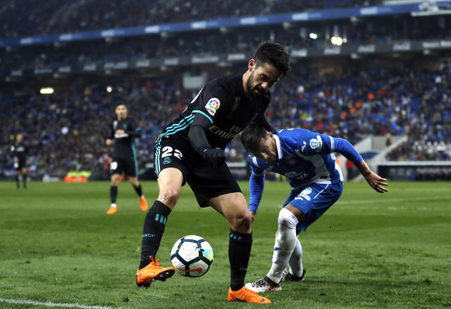 Real Madrid's Isco, left, duels for the ball with Espanyol's Pablo Patti during the Spanish La Liga soccer match between Espanyol and Real Madrid at RCDE stadium in Cornella Llobregat, Spain, Tuesday, Feb. 27, 2018. (AP Photo/Manu Fernandez)