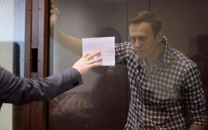 Alexei Navalny at his court hearing in Moscow, where he told the court he had no regrets about going back to Russia to a sure imprisonment  - REUTERS