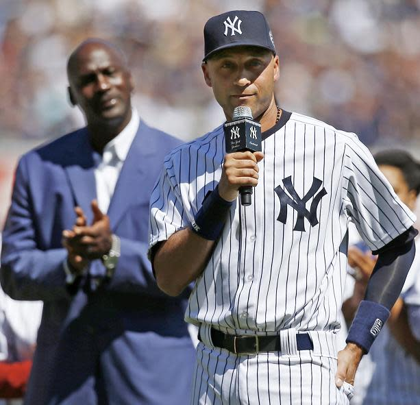 Michael Jordan watches on while Derek Jeter speaks in a pregame ceremony honoring his career in 2014. (AP)