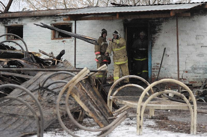 Firefighters work among the debris of the psychiatric hospital in the village of Alfyorovka on December 13, 2015 (AFP Photo/Andrei Arkhipov)