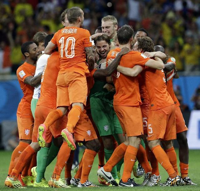 Netherlands' players celebrate after winning on penalty kicks the World Cup quarterfinal soccer match between the Netherlands and Costa Rica at the Arena Fonte Nova in Salvador, Brazil, Saturday, July 5, 2014. The Netherlands won 4-3. Late substitute Tim Krul, center, made two saves in a 4-3 penalty shootout victory over Costa Rica on Saturday to give the Netherlands a spot in the World Cup semifinals following a 0-0 draw.(AP Photo/Hassan Ammar)